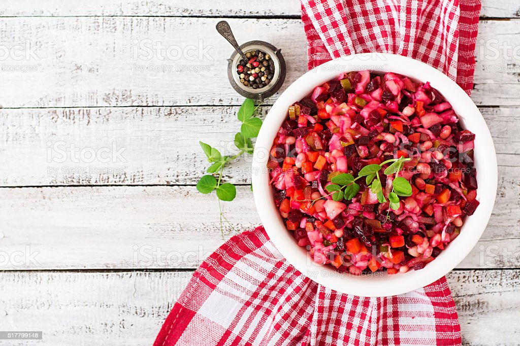 Beet salad Vinaigrette in a white bowl. Top view stock photo