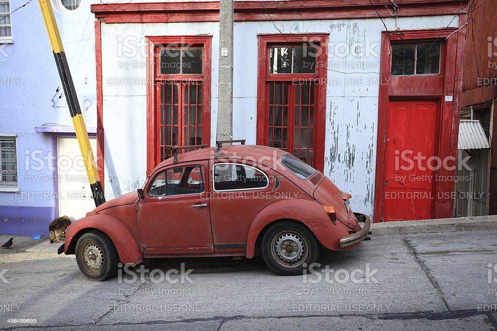 VW beetle in poor neighbourhood stock photo