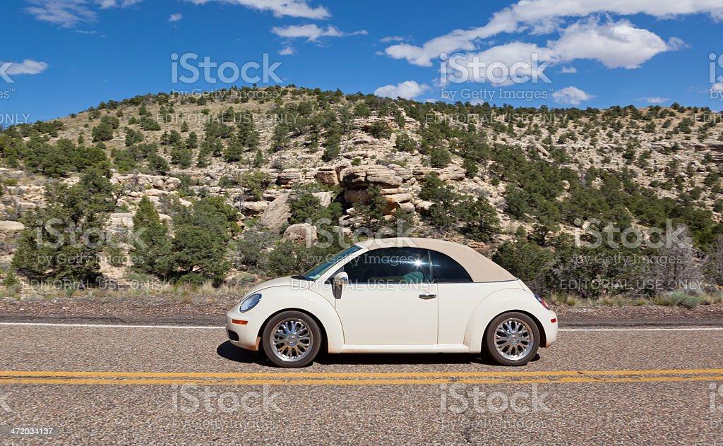 Beetle Volkswagen driving through Southwest USA stock photo