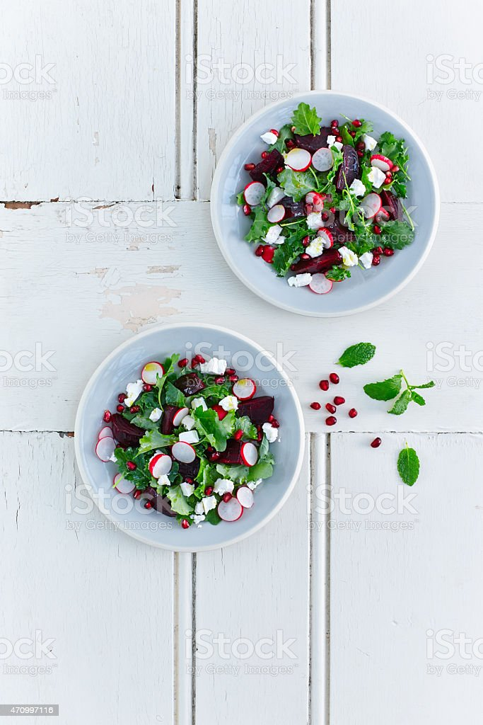 Beetroot and baby kale salad in bowls stock photo