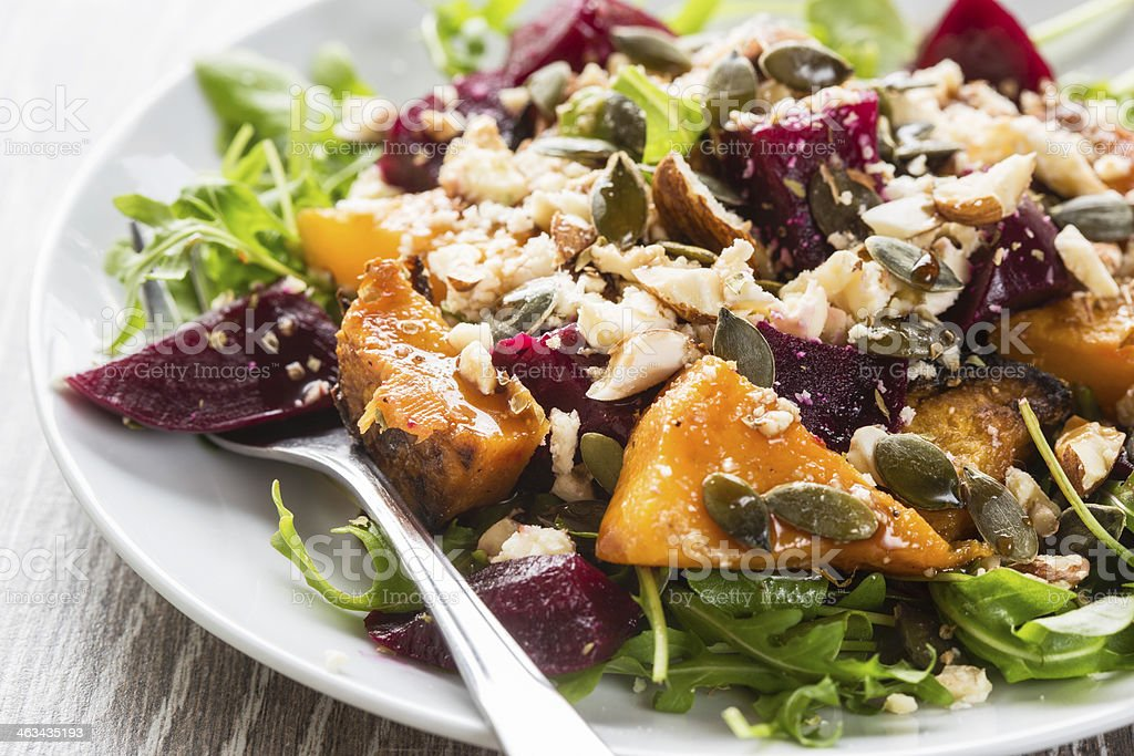 Beetroot and butternut salad with sauce stock photo