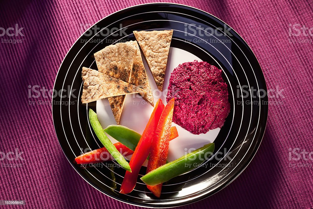 Beetroot hummus with vegetables an pita stock photo