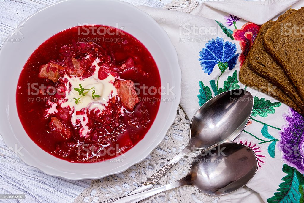 Beetroot soup, spoon, napkin on wooden background stock photo