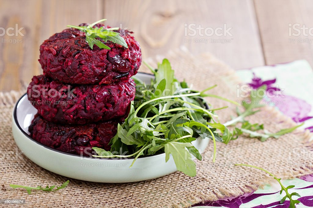 Beetroot vegan burgers with rice and beans stock photo