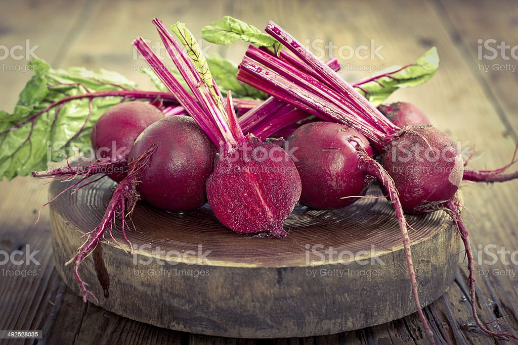 Beetroots on the wooden table stock photo