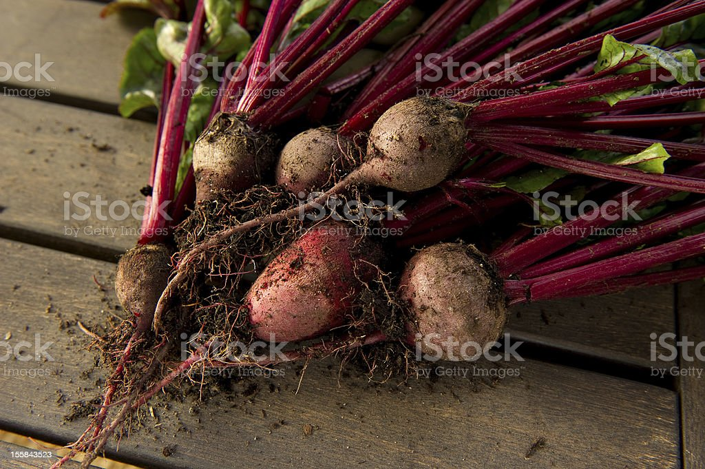 Beets on a wood background royalty-free stock photo