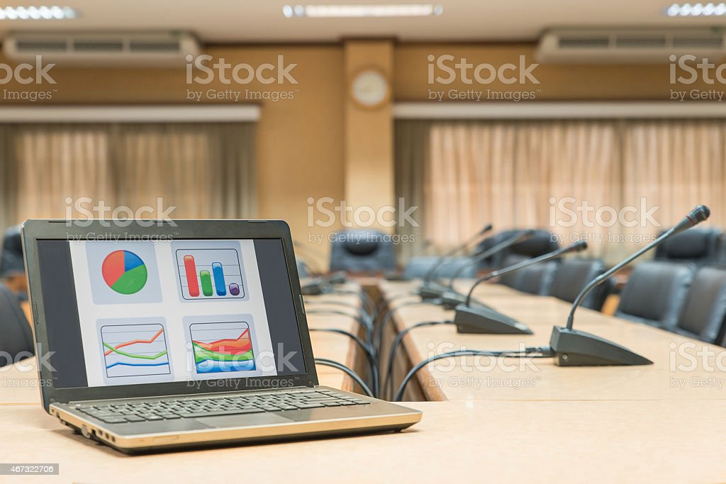 Before a conference,Laptop in front of empty chairs stock photo