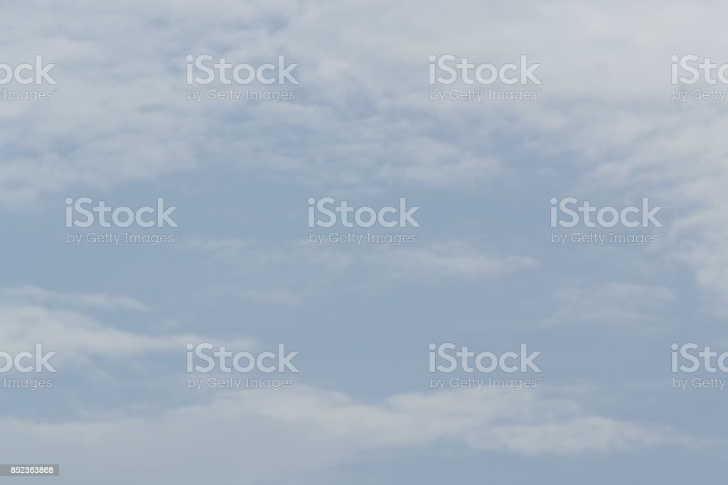 Before the rain fell, the clouds gathered together in the darkness of the sky. stock photo