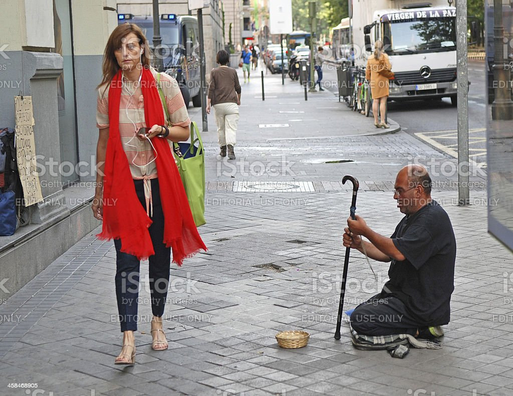 Beggar and beauty. royalty-free stock photo