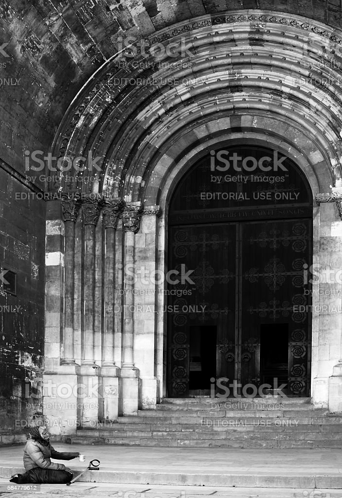 Beggar at the Cathedral Steps stock photo