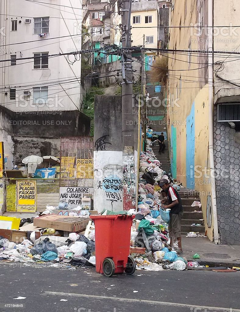 Beggar demand food and materials in garbage slum in Rio royalty-free stock photo