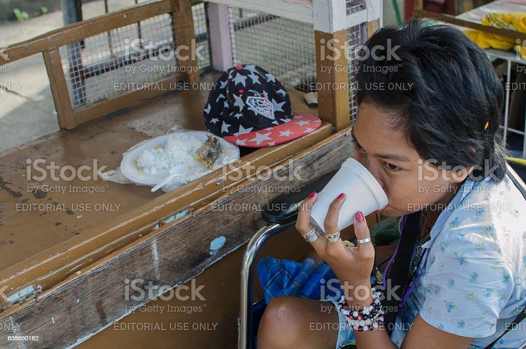 beggar  Enjoying A Sip Of Coffee While having pauper breakfast stock photo