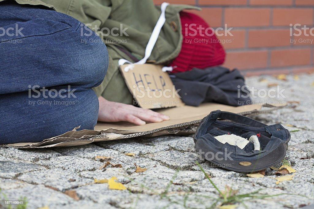 Beggar falling asleep on the street stock photo