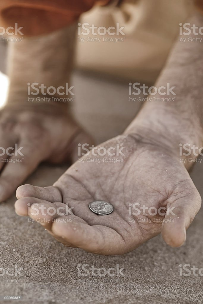 Beggar hand with coin stock photo
