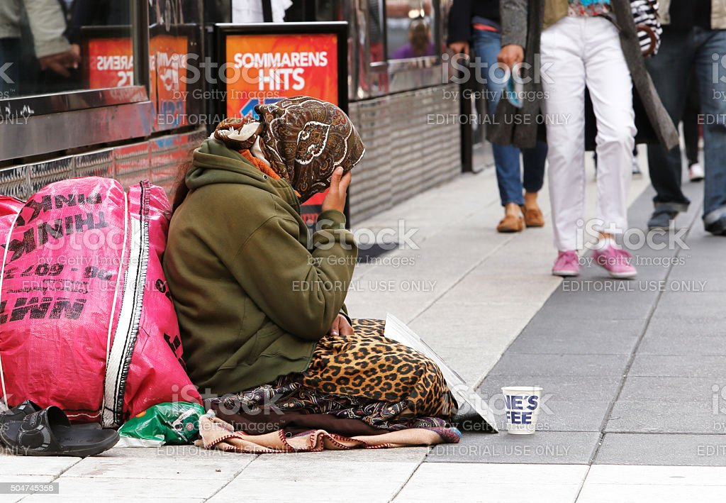 Beggar in Stockholm stock photo