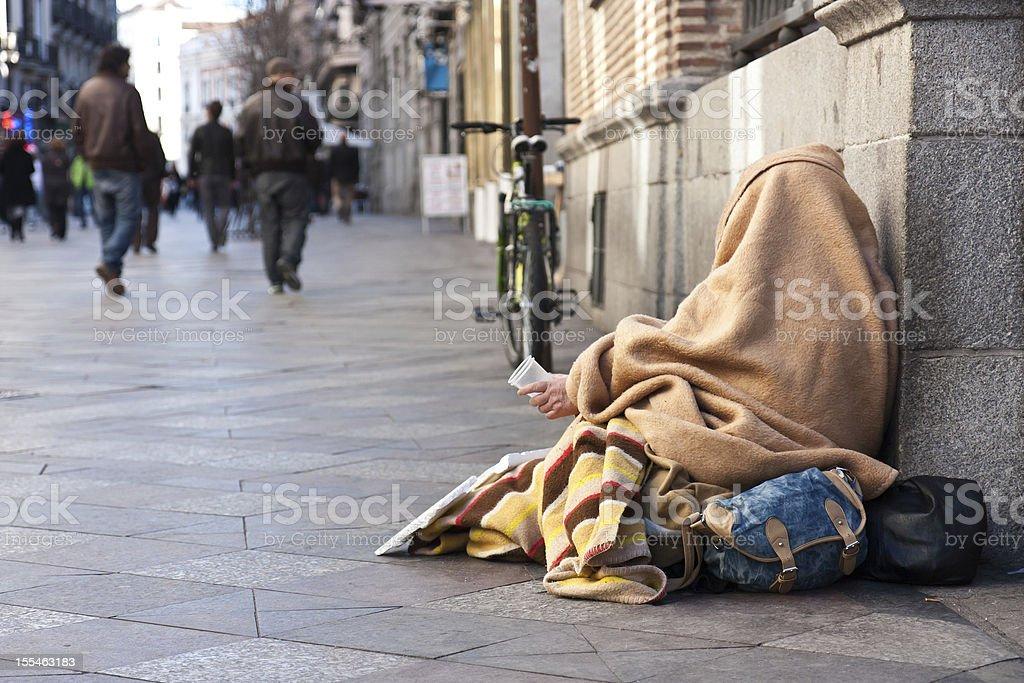 Beggar in the street stock photo
