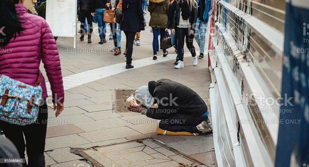 Beggar on the street of France stock photo