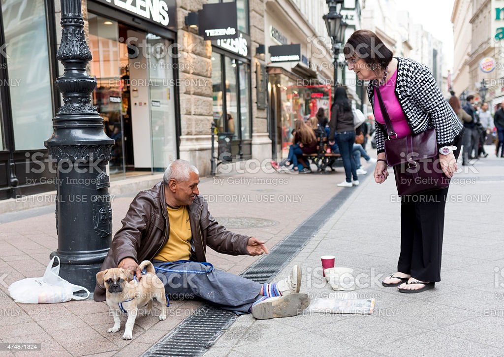Beggar with dog stock photo