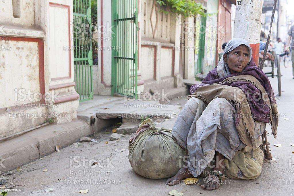 Beggar woman in streets of Varanasi royalty-free stock photo