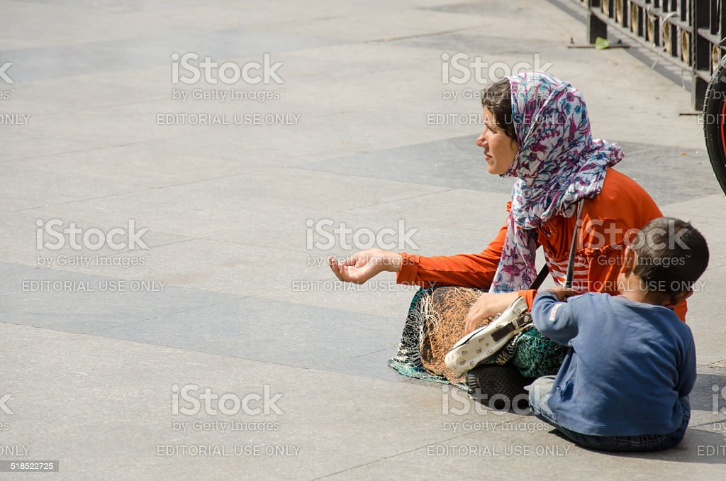 Beggar woman stock photo