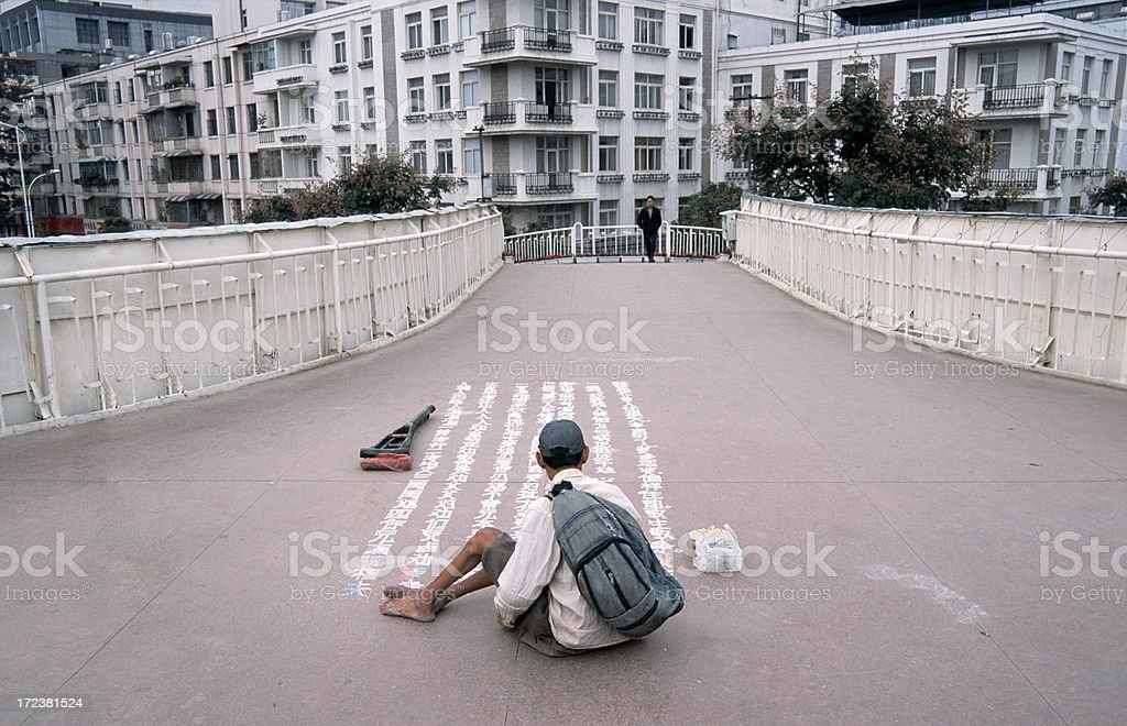 Beggar writing old chinese poem stock photo