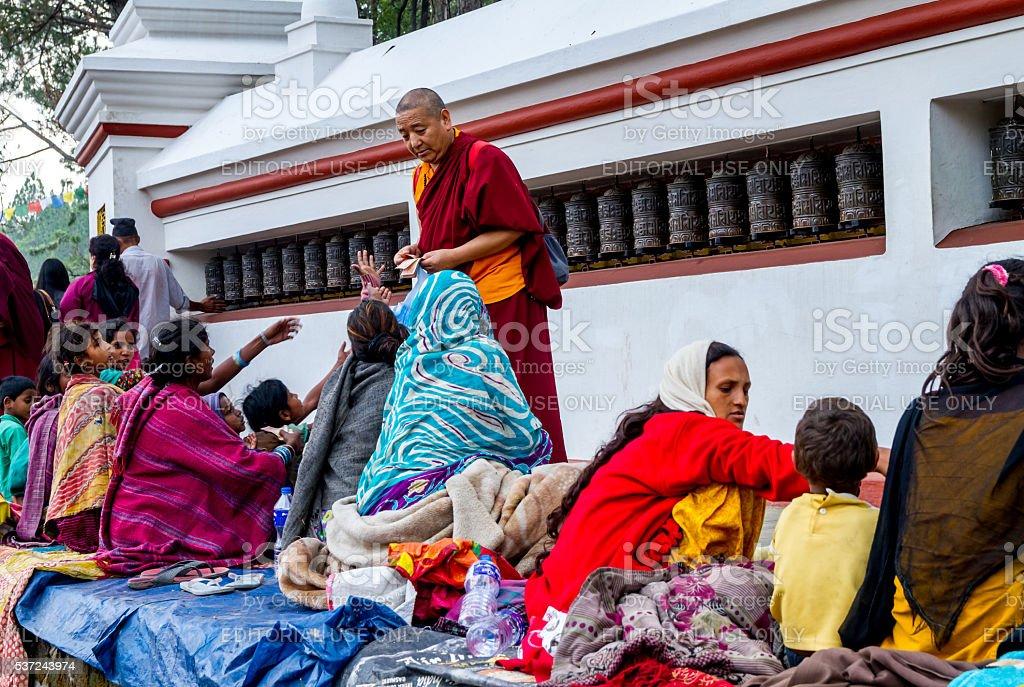 Beggars in Swayambhunath Stupa stock photo