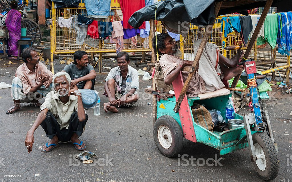 Beggars near Kalighat temple, Kolkata, India. stock photo