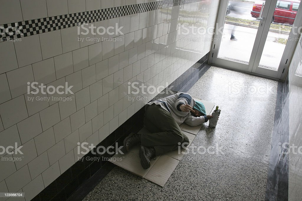 Begger in a hallway royalty-free stock photo