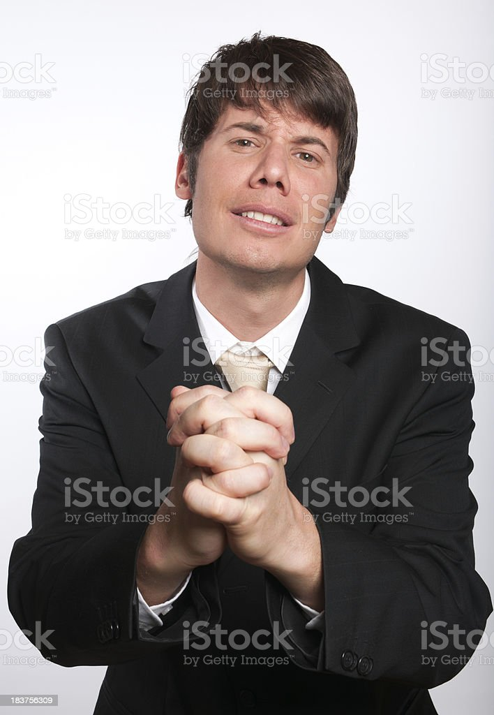 Begging Businessman with hands Praying (XXXL) royalty-free stock photo