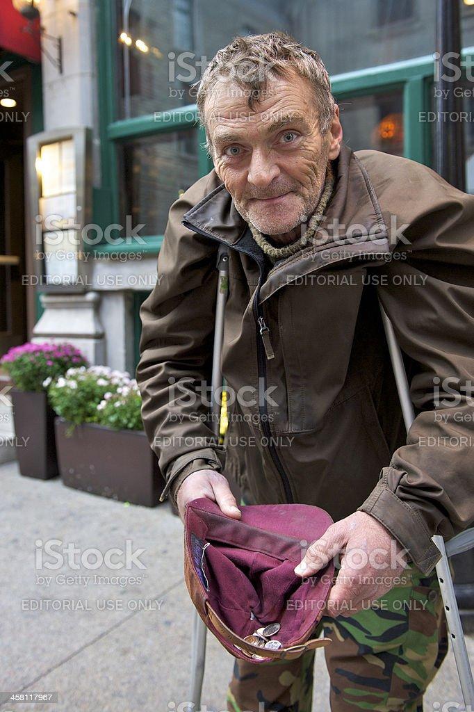 Begging for money on street corner royalty-free stock photo