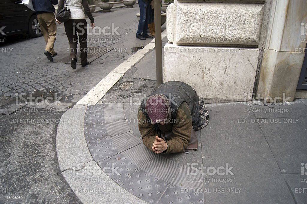 Begging old woman stock photo