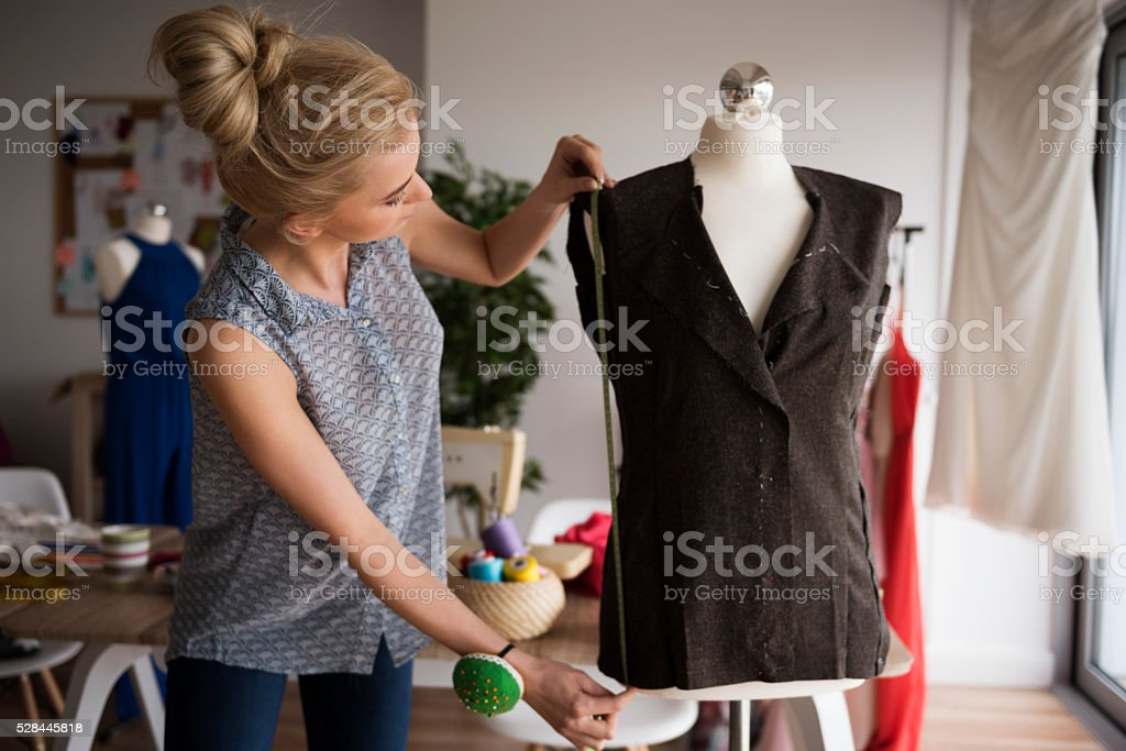 Begin of high fashion in small workshop stock photo