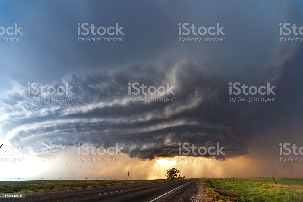 Beginning of a tornado on a deserted highway stock photo