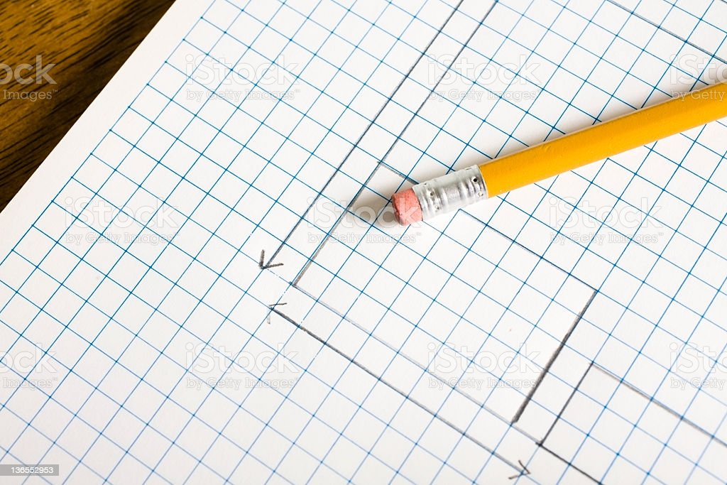 Beginning of plans drawn on pad with pencil. Grid paper. royalty-free stock photo