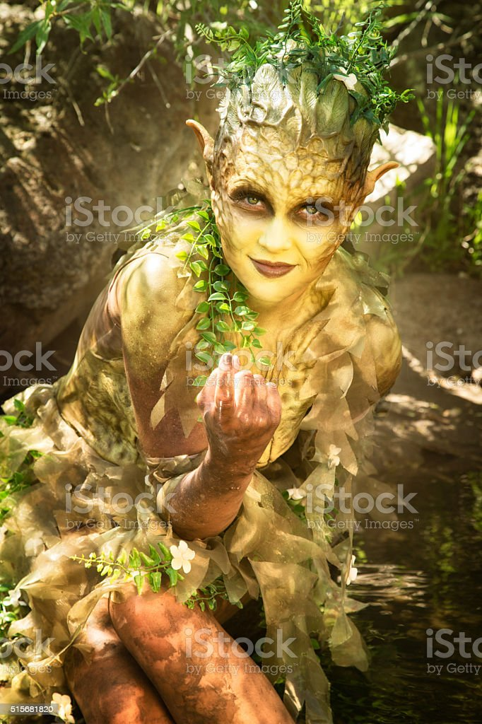 Beguiling water nymph gestures invitingly stock photo