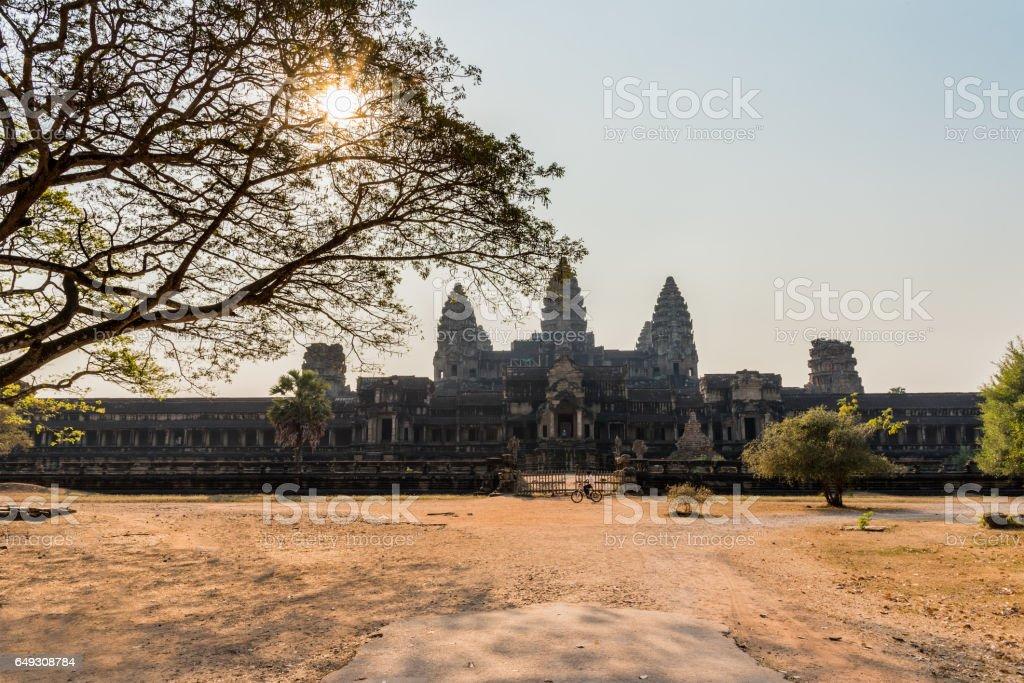 behind angkor wat in sunrize stock photo