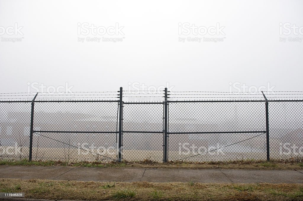 Behind Barbed Wire stock photo