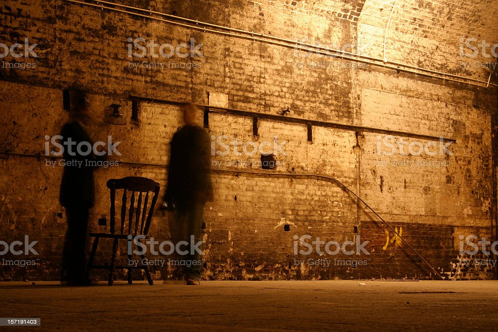Behind closed doors with shadows and chair royalty-free stock photo