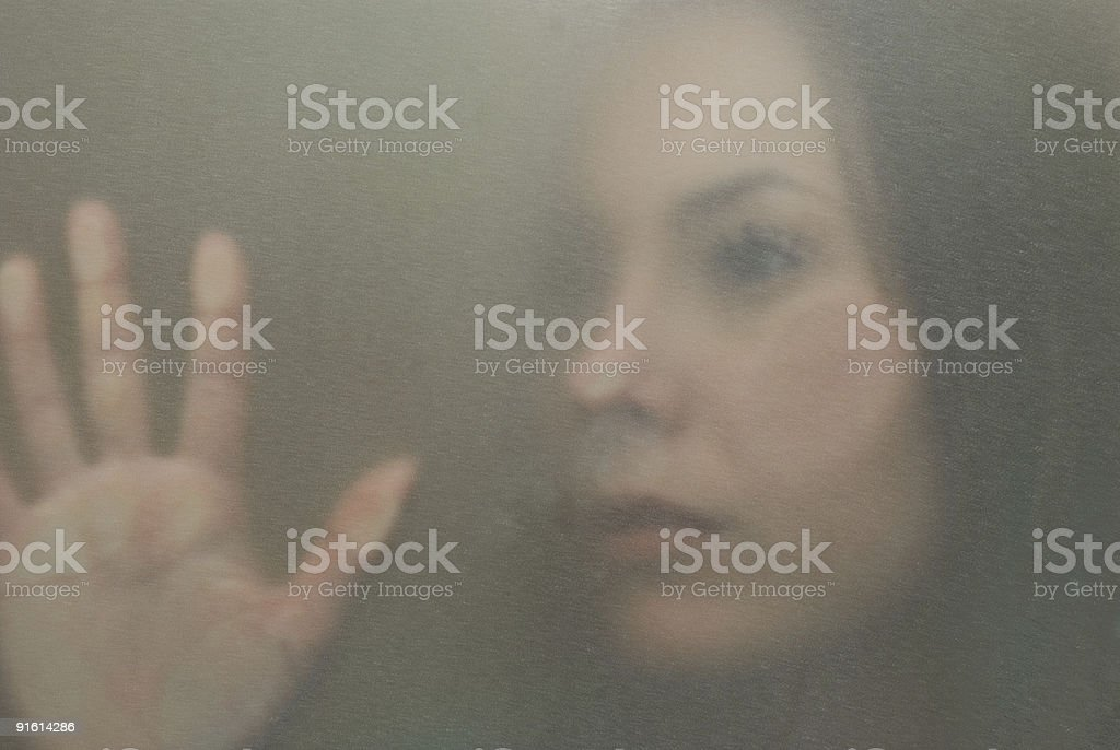 behind glass stock photo