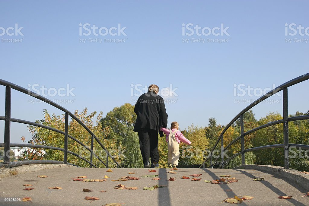 behind grandmother and baby on autumn bridge royalty-free stock photo