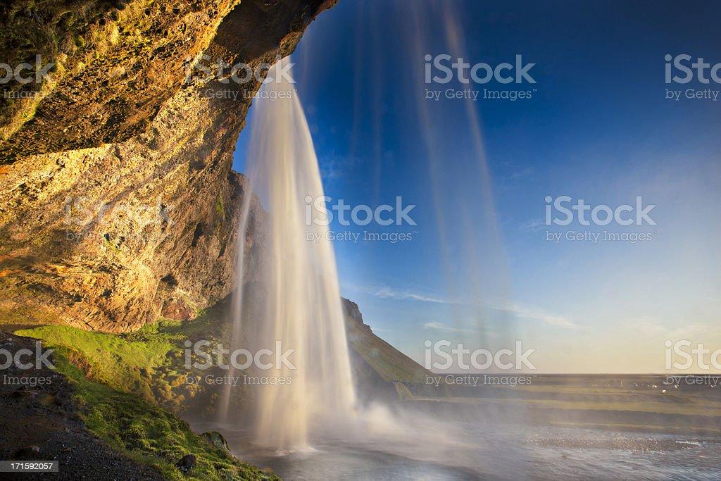 Behind Seljalandsfoss Waterfall stock photo