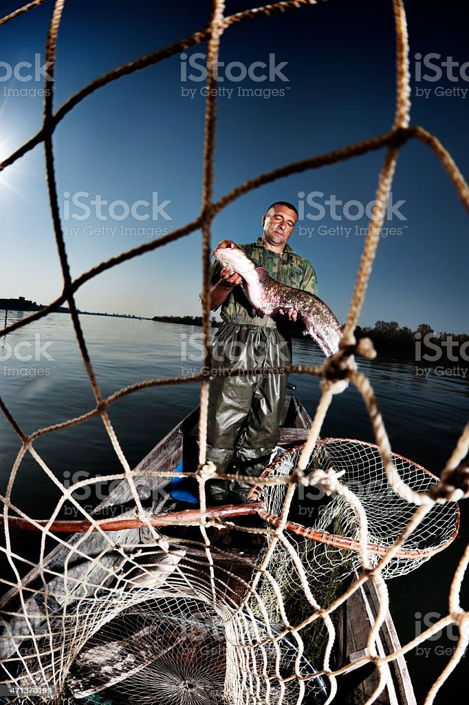 Behind the fisherman's net royalty-free stock photo