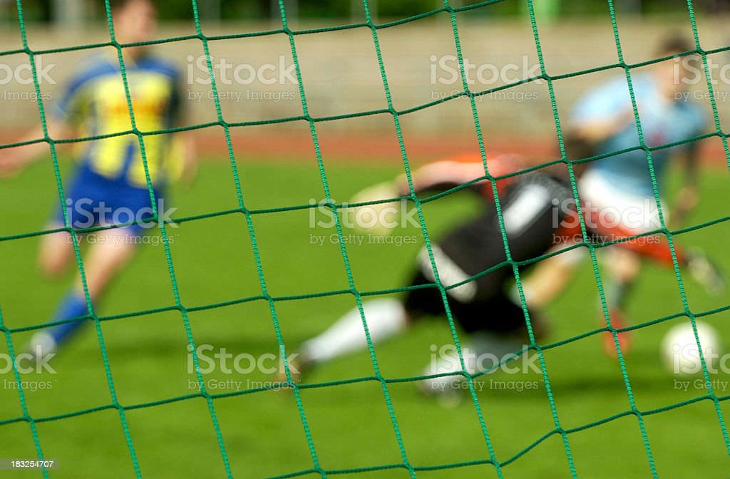 behind the goal neat royalty-free stock photo