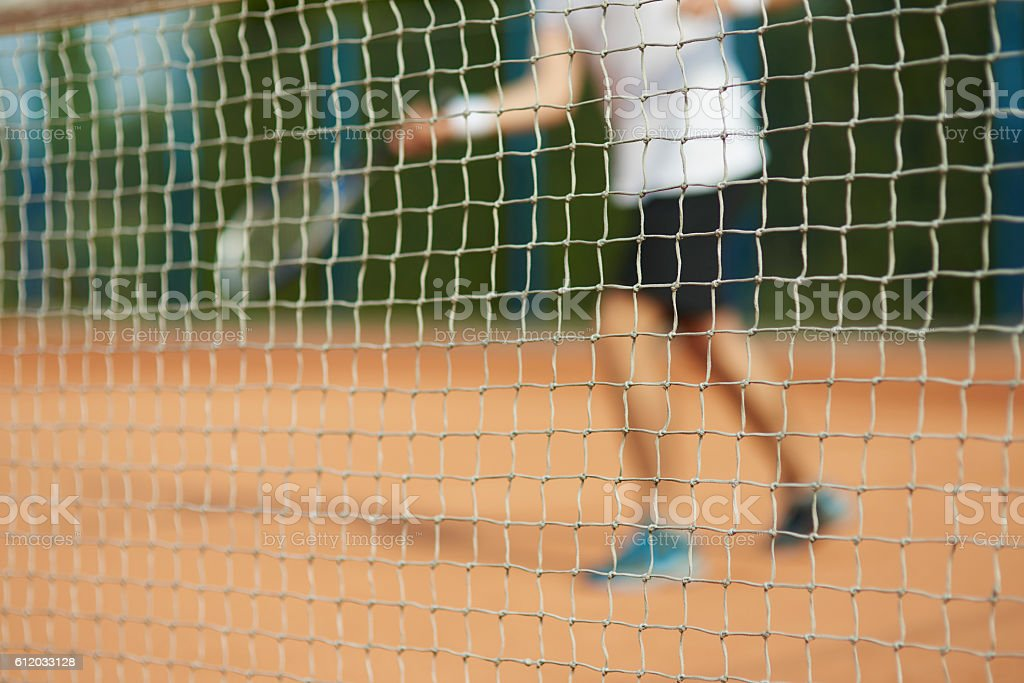 behind the net is a player stock photo