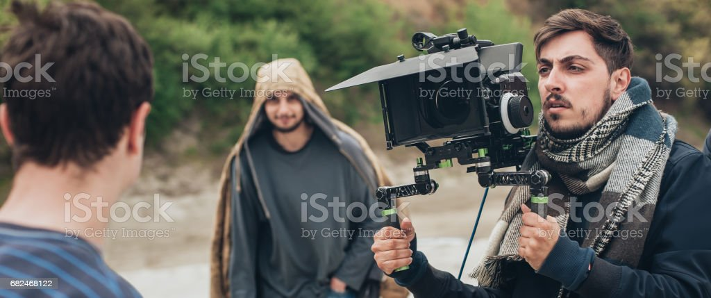 Behind the scene. Actor in front of the camera on the film set...