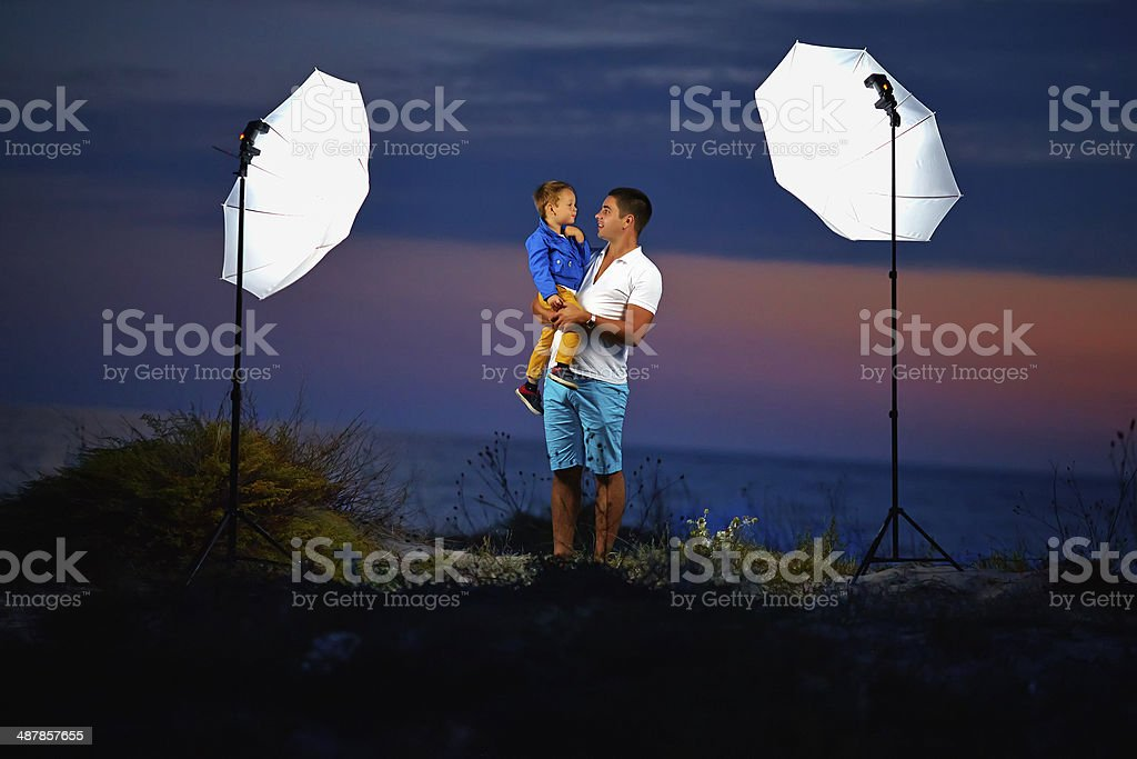 behind the scene, shooting outdoor portraits with flash lights stock photo