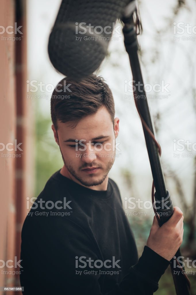 Behind the scene. Sound boom operator hold microphone fisher outdoor stock photo