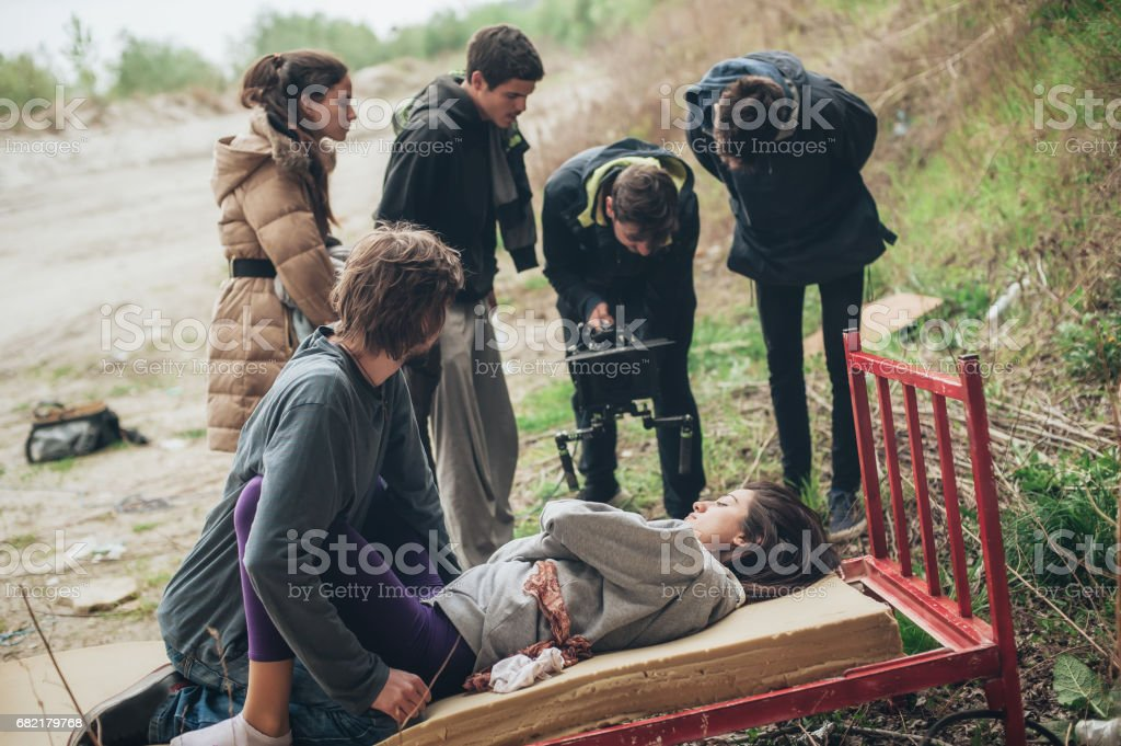 Behind the scene. Team filming couple in love during sex stock photo
