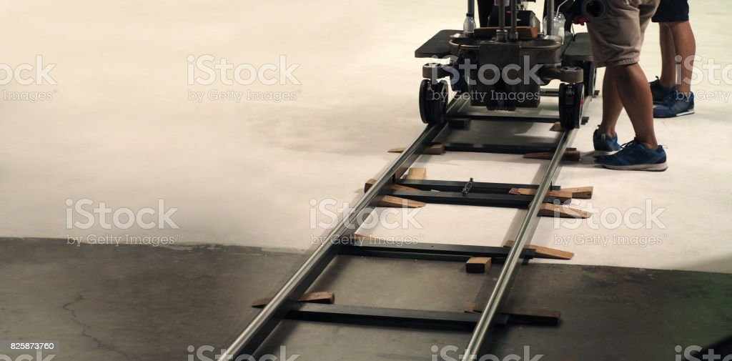 Behind the scenes of production team setting dolly track stock photo