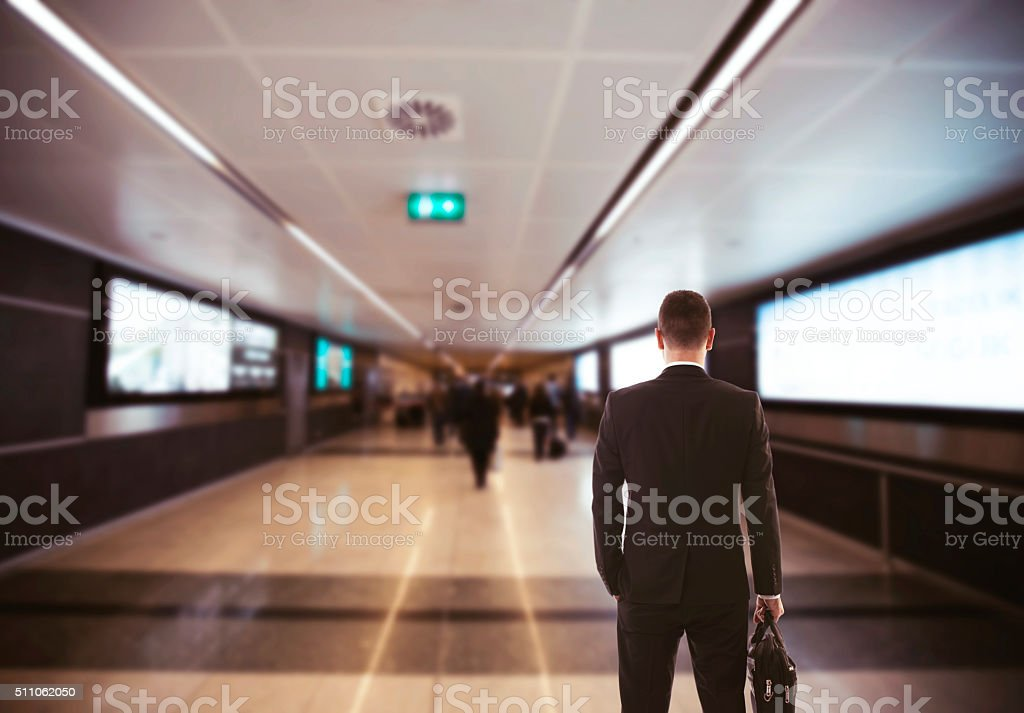 behind view of a businessman standing stock photo